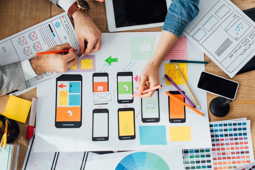 Top view of designers creative app interface for user experience design near layouts and digital